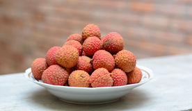 Famous tropical fruit - lychee. Fresh and sweet on the table Royalty Free Stock Photos