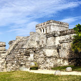 Famous Tulum ruins. Archaeological ruins of Tulum with blue sky stock photography