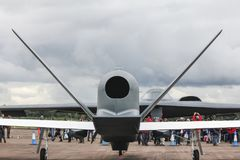 Predator UAV - Unmanned Air Vehicle and manned B2 Spirit Stealth nuclear bomber facing each other royalty free stock photo