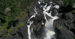 Uchar Waterfall in Altai with a rainbow stock footage