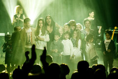 The famous Ukrainian singer Jamala smiles with a crowd of kids Stock Photography