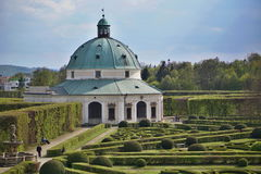 Famous Unesco gardens in Kromeriz town in Czech Republic with its green gardens in symmetrical pattern and decorated chateau Stock Images
