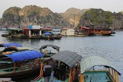 Famous UNESCO heritage site Ha Long Bay with fancy rocks, turquoise water and boats stock photos