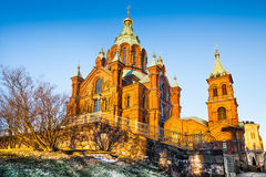 Famous Uspenski Cathedral at sunset in Helsinki, Finland. Beautiful view of famous Eastern Orthodox Uspenski Cathedral (Uspenskin katedraali) on a hill in the stock photo