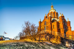 Famous Uspenski Cathedral at sunset, Helsinki, Finland. Beautiful view of famous Eastern Orthodox Uspenski Cathedral (Uspenskin katedraali) on a hill in the royalty free stock photos