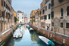 Famous Venetian water canals, historic houses and boats. Stock Image