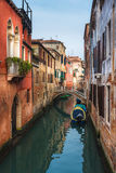Famous Venetian water canals, historic houses and boats. Royalty Free Stock Images