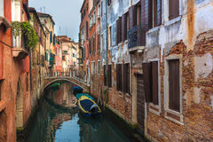 Famous Venetian water canals, historic houses and boats. Stock Photos