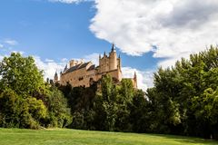 The famous view of the Alcazar of Segovia in a sunny summer day from the view point of la Pradera de San Marcos, Segovia, Spain. The famous view of the Alcazar stock photos