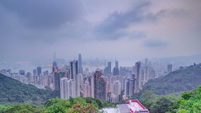 The famous view of Hong Kong from Victoria Peak night to day timelapse. Taken before sunrise with colorful clouds over stock video footage