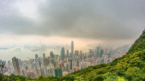 The famous view of Hong Kong from Victoria Peak timelapse. Taken at sunrise with colorful clouds over Kowloon Bay. stock video