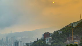 The famous view of Hong Kong from Victoria Peak timelapse. Taken at sunrise while the sun climbs over hill in Kowloon stock video