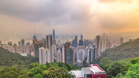 The famous view of Hong Kong from Victoria Peak timelapse. Taken at sunrise while the sun climbs over Kowloon Bay. stock footage