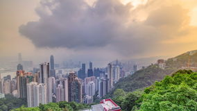 The famous view of Hong Kong from Victoria Peak timelapse. Taken at sunrise while the sun climbs over Kowloon Bay. stock video
