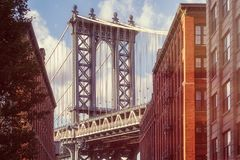 Famous view of the Manhattan Bridge from an old street in Brooklyn Stock Images