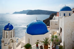 Famous view of Santorini. Famous Blue Domed churches on the sea background in Santorini, Greece Royalty Free Stock Image
