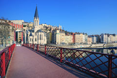 Famous view of Saone river and red footbridge in Lyon city Royalty Free Stock Photo