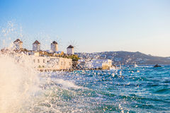 Famous view of traditional greek windmills on Mykonos island at sunrise, Cyclades, Greece Royalty Free Stock Photography