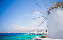 Famous view of traditional greek windmills on Mykonos island at sunrise, Cyclades, Greece Stock Photo
