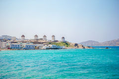 Famous view of traditional greek windmills on Mykonos island at sunrise, Cyclades, Greece Stock Image