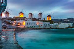 Traditional windmills at sunrise, Santorini, Greece Stock Images