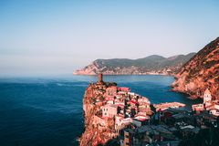 Famous view of the Vernazza old town Italy Cinque terre in the early morning sunrise view, colorful traditional building houses an. Colorful architecture of stock photo
