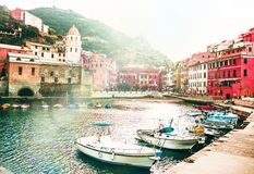 Famous view of the Vernazza old town Italy Cinque terre in the early morning sunrise view, colorful traditional building houses an royalty free stock image