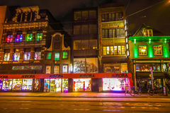 Famous vintage buildings of Amsterdam city at night time. General landscape view at tradition Dutch arcitecture. AMSTERDAM, NETHERLANDS - JANUARY 10, 2017 Royalty Free Stock Photography