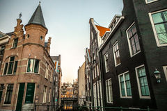Famous vintage buildings of Amsterdam city at sun set. General landscape view at tradition Dutch architecture. Royalty Free Stock Photos