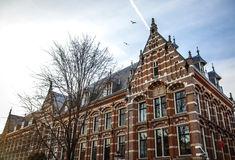 Famous vintage buildings of Amsterdam city at sun set. General landscape view at tradition Dutch architecture. Stock Photos