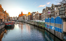 Famous vintage buildings of Amsterdam city at sun set. General landscape view at tradition Dutch architecture. Stock Photography
