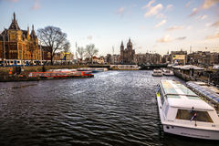 Famous vintage buildings & chanels of Amsterdam city at sun set. General landscape view Royalty Free Stock Photos