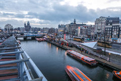 Famous vintage buildings & channels of Amsterdam city at sun set. General landscape view Royalty Free Stock Photo