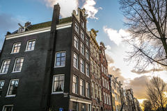 Famous vintage buildings & channels of Amsterdam city at sun set. General landscape view Stock Image