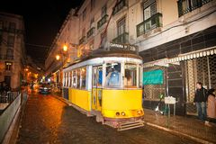 Free Famous Vintage Yellow 28 Tram Of Of Alfama, In The Oldest District Of The Old Town, At Night, Lisbon, Portugal Stock Images - 134430024