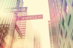Famous Wall Street sign in Manhattan, NYC. Famous Wall Street sign in the street of Manhattan, New York City, USA - vintage toned Stock Photography