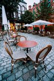 Famous Water Castle Restaurant in Speicherstadt, Outside. Tables and chairs at cobbled square. Hamburg, Germany Stock Photo