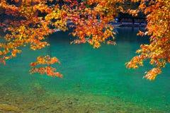 Pleasure boat at Arashiyama in Autumn season. The famous ways to explore Arashiyama is by renting a boat stock photography