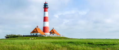 Famous Westerheversand lighthouse at North Sea, Germany Stock Image