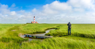 Famous Westerheversand lighthouse at North Sea, Schleswig-Holstein, Germany Stock Photo