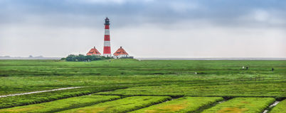 Famous Westerheversand lighthouse at North Sea, Schleswig-Holstein, Germany Royalty Free Stock Photo