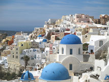 The famous white and blue Greek Islands style architecture of Oia village, Santorini island Stock Image