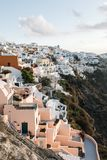 Famous white buildings of Oia town in Santorini. View of famous white buildings of Oia town on cliff in Santorini, Greece Stock Images