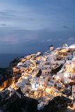Famous white buildings of Oia town in Santorini. View of famous white buildings of Oia town on cliff in Santorini, Greece Stock Photos