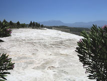 Famous white calcium travertines and pools in Pamukkale, Turkey. Stock Photography