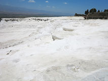 Famous white calcium travertines and pools in Pamukkale, Turkey. Royalty Free Stock Photos