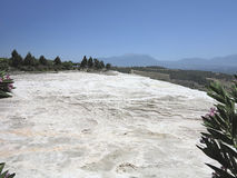 Famous white calcium travertines and pools in Pamukkale, Turkey. Stock Photos
