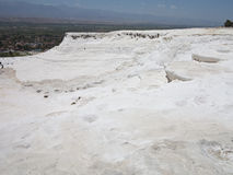Famous white calcium travertines and pools in Pamukkale, Turkey. Stock Image