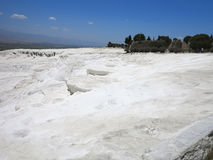 Famous white calcium travertines and pools in Pamukkale, Turkey. Royalty Free Stock Image