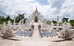 Famous white church in Wat Rong Khun Stock Image